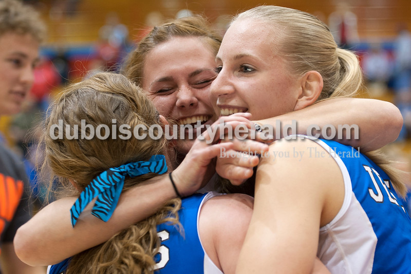 Olivia Corya/The Herald<br /> Northeast Dubois senior Taylor Borden hugged her friends Talia Terwiske, left, and Nicole Dodd, right, after they and their teammates won the Class 1A girls volleyball sectional championship at Tecumseh on Saturday. The Jeeps won 3-2.