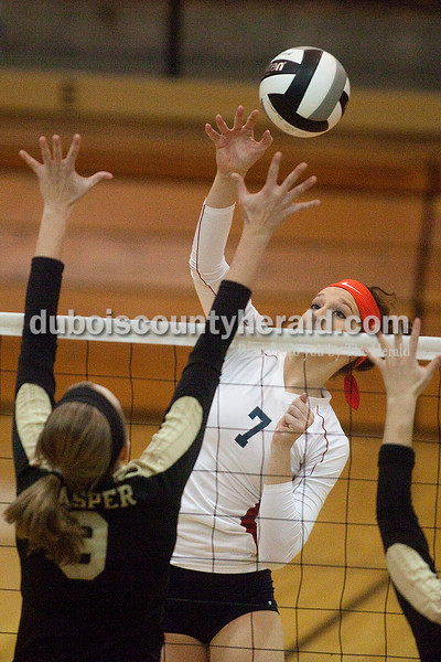 Rachel Mummey/The Herald<br /> Heritage Hills' Madison Fella spiked the ball during their match against Jasper in the Class 3A volleyball sectional championship at Cabby O'Neill Gymnasium on Saturday.