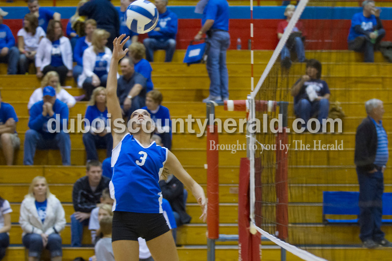 Olivia Corya/The Herald<br /> Northeast Dubois' Emily Lueken spiked the ball during a warm up before the Class 1A girls volleyball sectional championship at Tecumseh on Saturday. The Jeeps won 3-2.