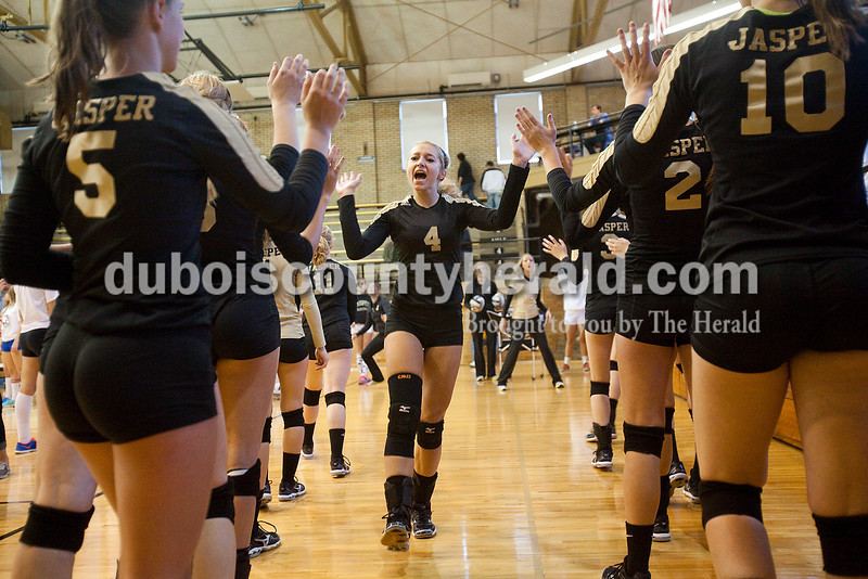 Rachel Mummey/The Herald<br /> Jasper's Lydia Scherle high-fived her teammates during warm ups before the start of the Class 3A volleyball sectional championship against Heritage Hills at Cabby O'Neill Gymnasium on Saturday.