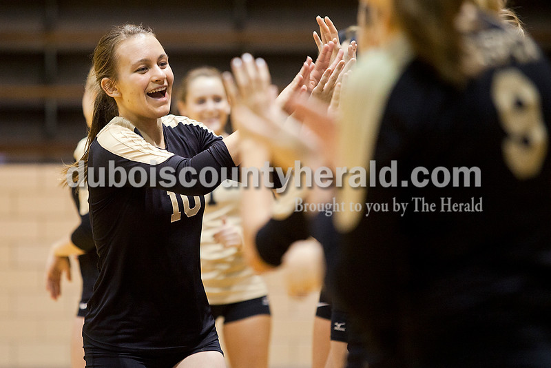 Rachel Mummey/The Herald<br /> Jasper's Megan Stenftenagel high-fived her teammates during player introductions before the start of the Class 3A Volleyball Regional in Mount Vernon on Tuesday. Jasper won in the fifth match 15-13.