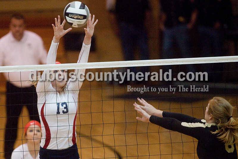 Rachel Mummey/The Herald<br /> Heritage Hills' Kaebra LaGrange blocked a spike by Jasper's Tori Sermersheim during their match against Jasper in the Class 3A volleyball sectional championship at Cabby O'Neill Gymnasium on Saturday.