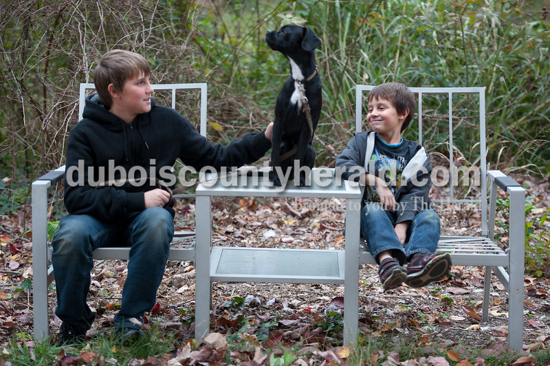"Olivia Corya/The Herald<br /> Brothers Matthew, 12, left, and Seth Drew, 8, sat with their eleven month old puppy Lincoln outside their family's Jasper home Tuesday. They agreed that the personality of their pup is best described as ""crazy."""