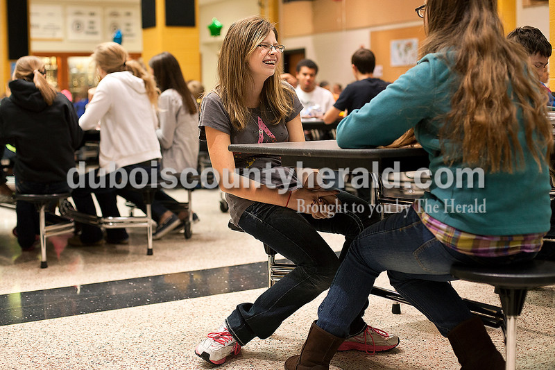 Dave Weatherwax/The Herald<br /> Jasper Middle School seventh-graders Katlyn Land, left, and Stephanie Pierick-Lewis shared a laugh together as they answered conversation starter questions during lunch Tuesday in the school cafeteria. The middle school students were encouraged to sit with students they don't normally sit with for annual Mix It Up at Lunch Day as an attempt to break down social and racial barriers. Katlyn and Stephanie said they have two classes together at school, but aren't friends outside of school and found the questions to be helpful in getting to know each other more.