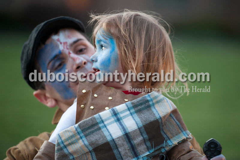 Olivia Corya/The Herald<br /> Adam Ramsey of St. Anthony, 2, went trick or treating with his dad Patrick Ramsey while the two of them dressed up as William Wallace, the Scottish historical hero and subject of the movie Braveheart, in Jasper on Wednesday. Patrick said the costume was meaningful because his family is of Scottish ancestry.