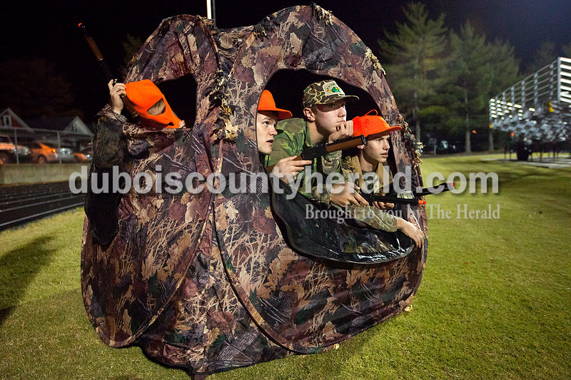 Jasper seniors Kirk Stenftenagel, left, Issac Lechner, Mark Giesler and Nate Messier spent halftime during Friday night's Class 4A sectional championship game against Evansville Reitz in a hunting blind at Jerry Brewer Alumni Stadium in Jasper. The Wildcats lost 31-30. Dave Weatherwax/The Herald
