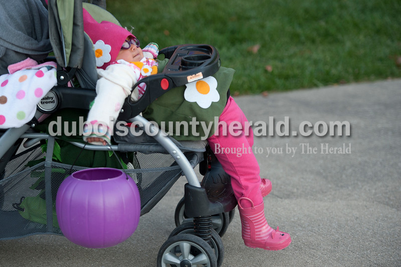 Olivia Corya/The Herald<br /> Kenleigh Racicot of Schnellville, 1, took it easy as her mom pushed her from house to house in a Jasper neighborhood while trick or treating on Wednesday night. Kenleigh was dressed as a gnome.