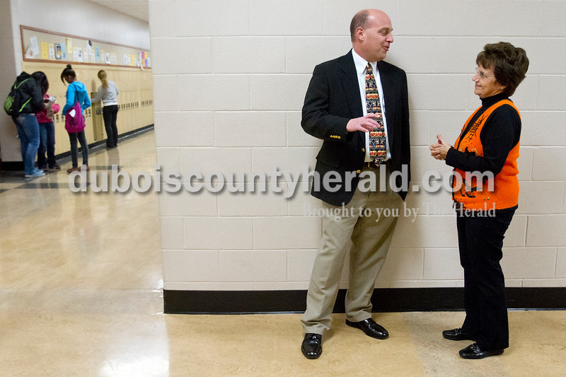 "Olivia Corya/The Herald<br /> Jason Schmitt of Jasper, who is an alumnus of Jasper High School and Vice President of loans at Springs Valley Bank, caught up with his former algebra teacher Brenda Wagner between class periods as he returned to his old school as ""Principal for a Day"" on Wednesday. Schmitt shadowed Principal Brian Wilson, learned how to evaluate teachers, and supervised the lunch room during the high school's first of two such events. The second ""Principal for a Day"" event will be in December."