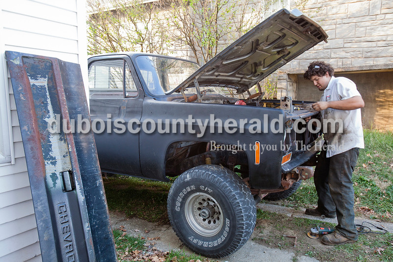 Rachel Mummey/The Herald<br /> Nathan Wood of Jasper worked on his 1979 Chevy Custom Deluxe in his driveway on Jackson St. in Jasper on Thursday. Wood bought the truck, which he calls Black Betty, in February and has been rebuilding it one paycheck at a time since then.