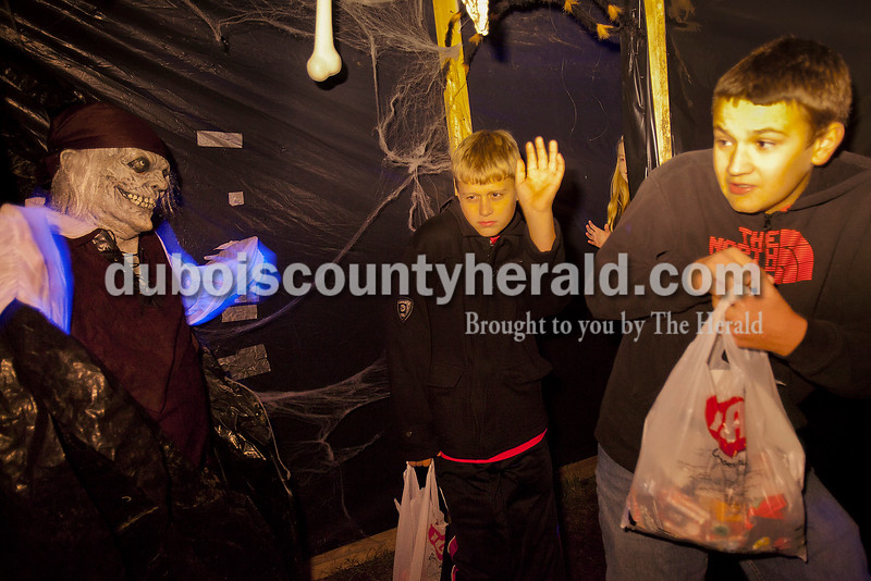 Mitchell Carter, 12, and Eli Lubbehusen, 13 both of Huntingburg leapt backwards as Don Hayes of Otwell jumped out at him in Davy Jones' Locker portion of the haunted pirate ship on Halloween. The boys were their with friend's Joe Hildenbranski and Nicole Eckert, both 13 and of Huntingburg. This year the zombie pirates happily scared around 340 trick or treaters.