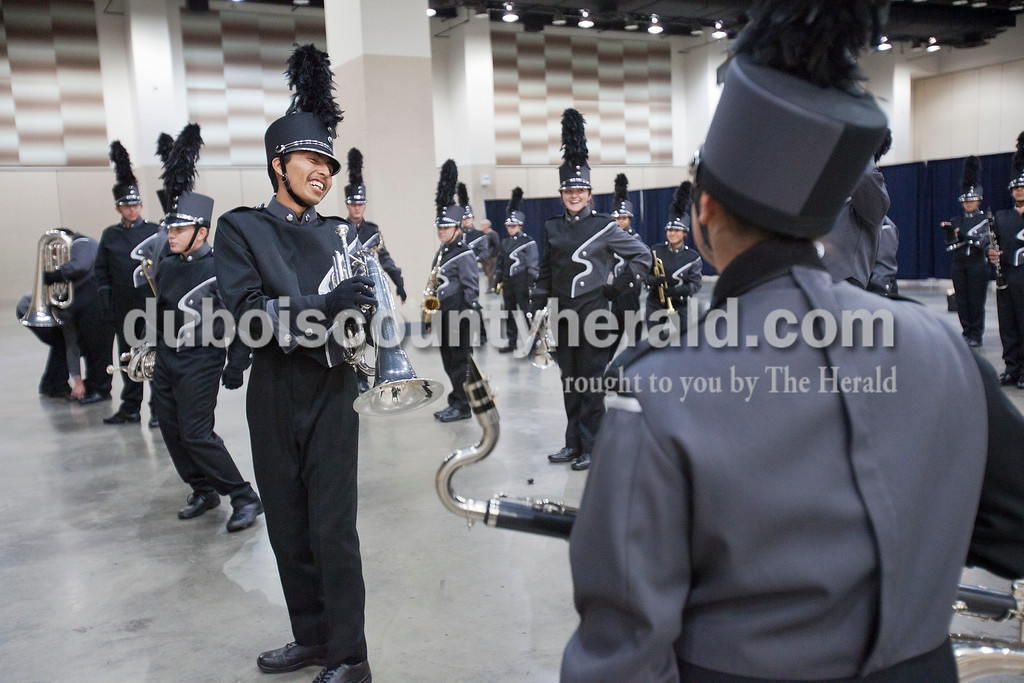 Southridge senior Irvin Rocha stretched out his lower back while warming up at the Indiana State School Music Association State Marching Band Finals in Indianapolis Saturday.