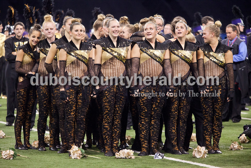 Rachel Mummey/The Herald<br /> Forest Park color guard members soaked in their victory after winning 1st place during the award ceremony at the Indiana State School Music Association State Marching Band Finals in Indianapolis Saturday.