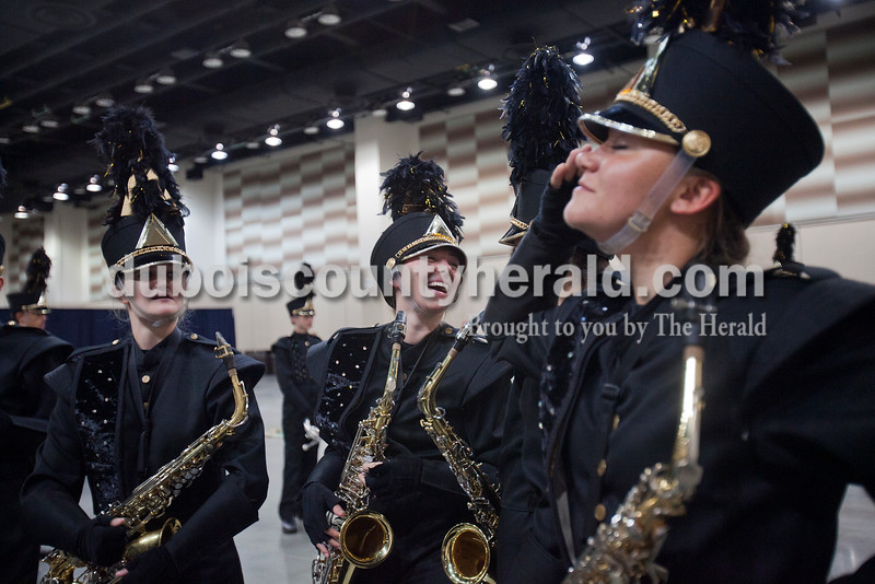 Jasper seniors Kayla Judy, Jacqueline Hurst, Emily Jones and Janelle Gore shared a laugh while waiting in the warm up room at the Indiana State School Music Association State Marching Band Finals in Indianapolis Saturday.