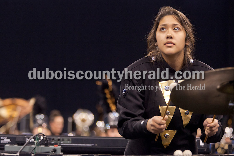 Southridge senior Araceli Garcia looked up for a moment to check tempo with the drum major as she played the marimba during the Riaders' performance at the Indiana State School Music Association state marching band finals at Lucas Oil Stadium in Indianapolis on Saturday.