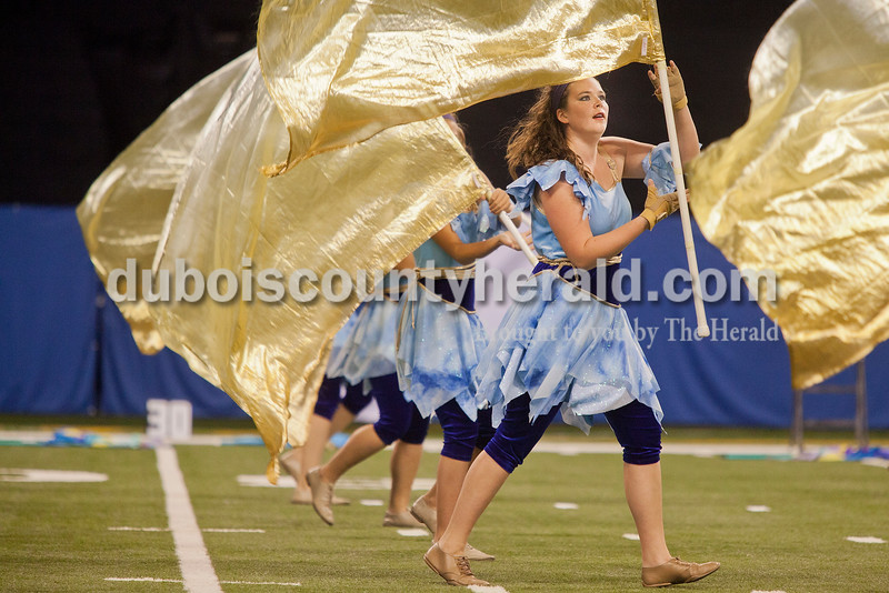 Jasper senior color guard Tarryn Roos carried a flag during their performance at the Indiana State School Music Association State Marching Band Finals in Indianapolis Saturday