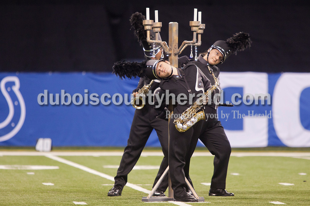 Southridge sophomore Theresa Stetter, center, senior Olivia Schilling, right, and junior Brayden Meyer danced next to a candelabra during their performance at the Indiana State School Music Association State Marching Band Finals in Indianapolis Saturday.