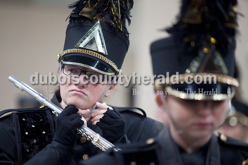 Jasper junior Audra Tart adjusted her hat's chin strap during warm ups at the Indiana State School Music Association State Marching Band Finals in Indianapolis Saturday