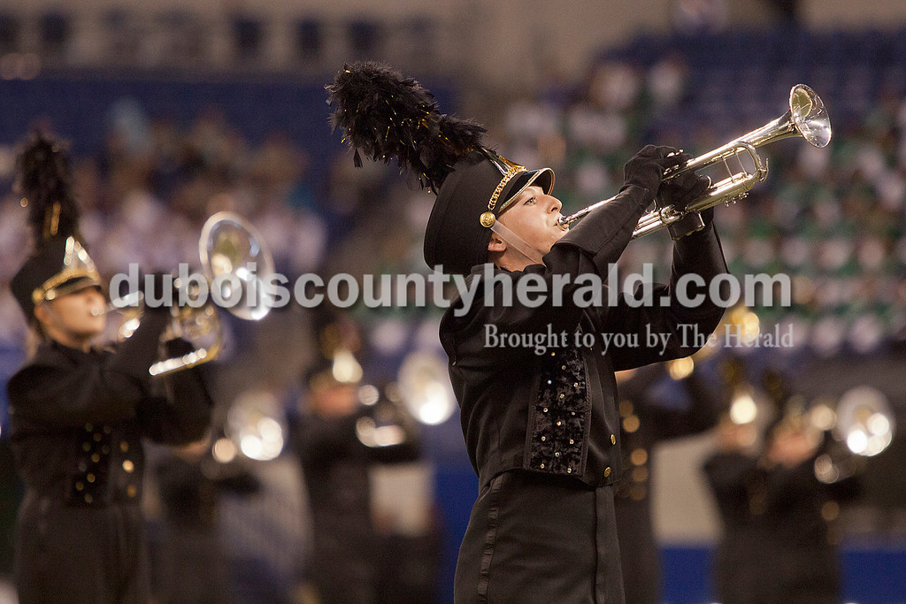 Jasper senior Maddie Messmer played a trumpet solo while senior Kari Keeley soloed on the mellophone in the background during the Marching Wildcats performance at the Indiana State School Music Association State Marching Band Finals in Indianapolis Saturday.
