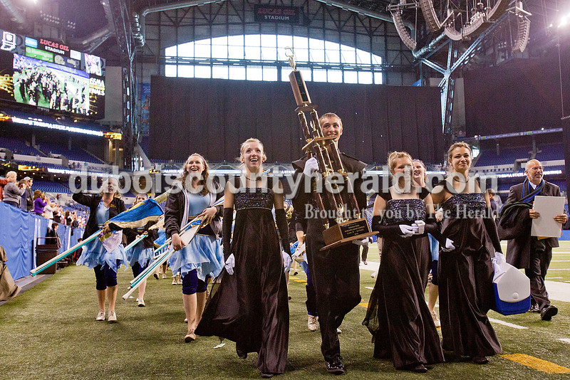Jasper drum majors junior Avery Charron, senior Zach Grewe, junior Courtney Hayden, and junior Olivia June led the Marching Wildcats' as <br /> they exited Lucas Oli Stadium carrying their first place trophy at the Indiana State School Music Association State Marching Band Finals in Indianapolis Saturday.