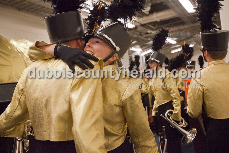 Forest Park freshman Sam Wendholt hugged fellow freshman Sara Weyer after the Rangers competed at the Indiana State School Music Association State Marching Band Finals in Indianapolis Saturday