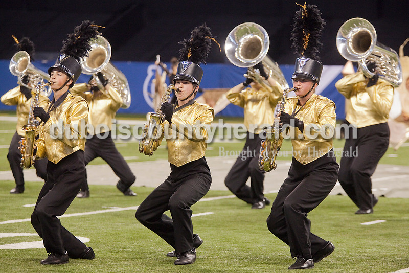 Forest Park saxophonists squatted in sync during their performance at the Indiana State School Music Association State Marching Band Finals in Indianapolis Saturday.
