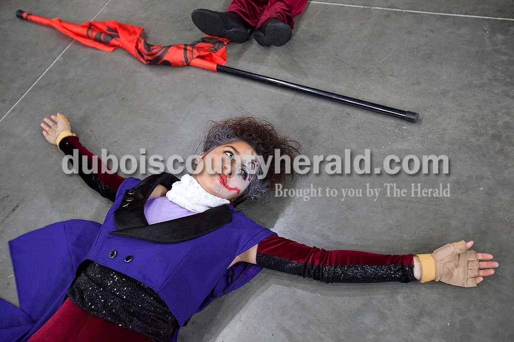 Southridge sophomore color guard Emily Calderon did a stretching exercise before performing at the Indiana State School Music Association State Marching Band Finals in Indianapolis Saturday