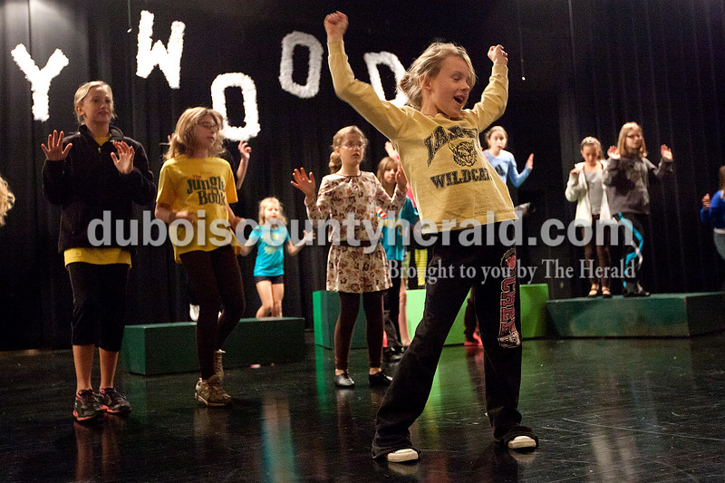 """Dave Weatherwax/The Herald<br /> Lauren Hayes of Jasper, 7, right, danced while belting out the song as she performed with 42 other children from Dance Central Academy of Performing Arts as they rehearsed their performance of """"The Jungle Book"""" on Saturday at the Jasper Middle School. Lauren plays the role of """"Mowgli."""""""