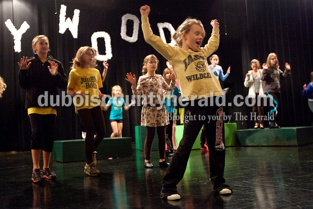 "Dave Weatherwax/The Herald<br /> Lauren Hayes of Jasper, 7, right, danced while belting out the song as she performed with 42 other children from Dance Central Academy of Performing Arts as they rehearsed their performance of ""The Jungle Book"" on Saturday at the Jasper Middle School. Lauren plays the role of ""Mowgli."""