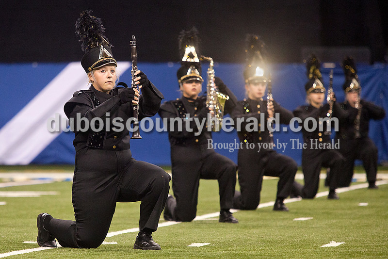 Jasper Marching Wildcats sophomores Ryan Fritz, Lindsey Welp,  Madeline Keller and Maddie Robling took a knee in formation during their performance at the Indiana State School Music Association State Marching Band Finals in Indianapolis Saturday.