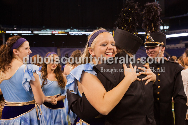 Hugs were plentiful as Jasper color guard senior Melanie Martin celebrated with members of the marching band after claiming first place at the Indiana State School Music Association State Marching Band Finals in Indianapolis Saturday.