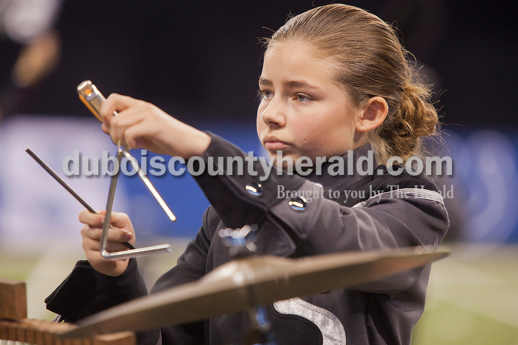 Southridge eighth grader Emma Kinker played the triangle during at the Indiana State School Music Association State Marching Band Finals in Indianapolis Saturday