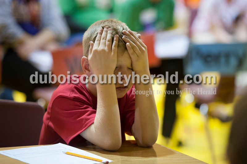 Olivia Corya/The Herald<br /> Precious Blood School fourth grader Kyle Sternberg reacted after misspelling a word during the Indiana Academic Spell Bowl Elementary Division at Ireland Elementary School on Thursday night.