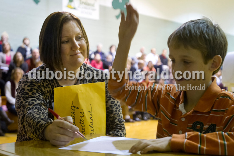 Olivia Corya/The Herald<br /> Proctor Candy Meyer from Petersburg Elementary School okayed Ireland Elementary School fourth grader Reece Fromme's word spelling during the Indiana Academic Spell Bowl Elementary Division at Ireland Elementary School on Thursday night. Ireland placed first in Class 4.