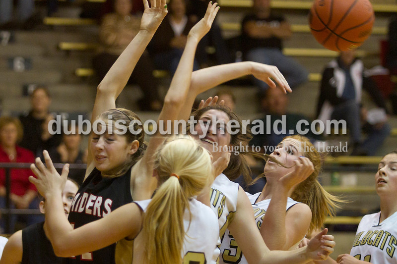 Olivia Corya/The Herald<br /> Southridge's Aubrey Main, far left, and Jasper's Nicolette Eckert, Brooke Lueken, Tori Sermersheim, and Emily Jones battled for the rebound during Saturday night's game at Cabby O'Neill Gymnasium. The Wildcats defeated the Raiders 44-28.