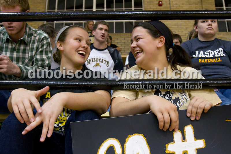 Olivia Corya/The Herald<br /> Jasper High School seniors Emily Beckman, left, and Jordan Burger chatted during Saturday night's Jasper versus Southridge girls basketball game at Cabby O'Neill Gymnasium.