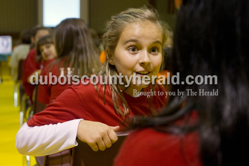 Olivia Corya/The Herald<br /> Huntingburg Elementary School fourth grader Briley King reacted to a teammate's score during the Indiana Academic Spell Bowl Elementary Division at Ireland Elementary School on Thursday night. Her school placed first in Class 3. Briley was the youngest member on her school's team competing that night.