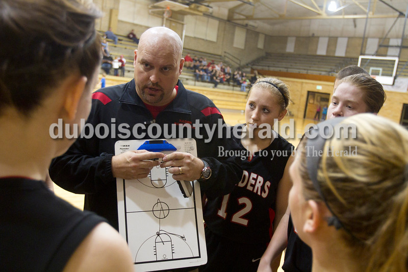 Olivia Corya/The Herald<br /> Southridge varsity coach Greg Werner strategized with the Lady Raiders, including Kayley Main, center right, during a time out in Saturday night's game against Jasper at Cabby O'Neill Gymnasium. The Wildcats defeated the Raiders 44-28.