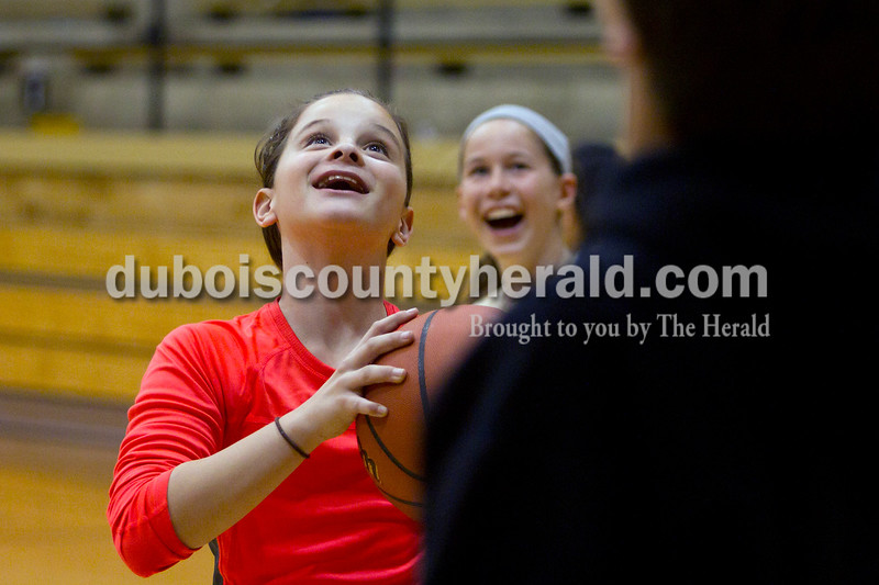 Olivia Corya/The Herald<br /> Grace Colvin, 11, left, and Hannah Schwenk, 10, both of Jasper, <br /> competed in a kids only game of knockout after the Jasper versus Southridge girls basketball match at Cabby O'Neill Gymnasium on Saturday night. The Wildcats defeated the Raiders 44-28.