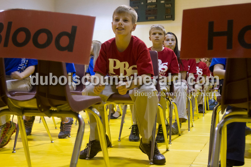 Olivia Corya/The Herald<br /> Precious Blood School fourth grader Kyle Sternberg reacted after a teammate spelled a word correctly during the Indiana Academic Spell Bowl Elementary Division at Ireland Elementary School on Thursday night. Spellers aren't scored individually, but rather contribute to the team total.