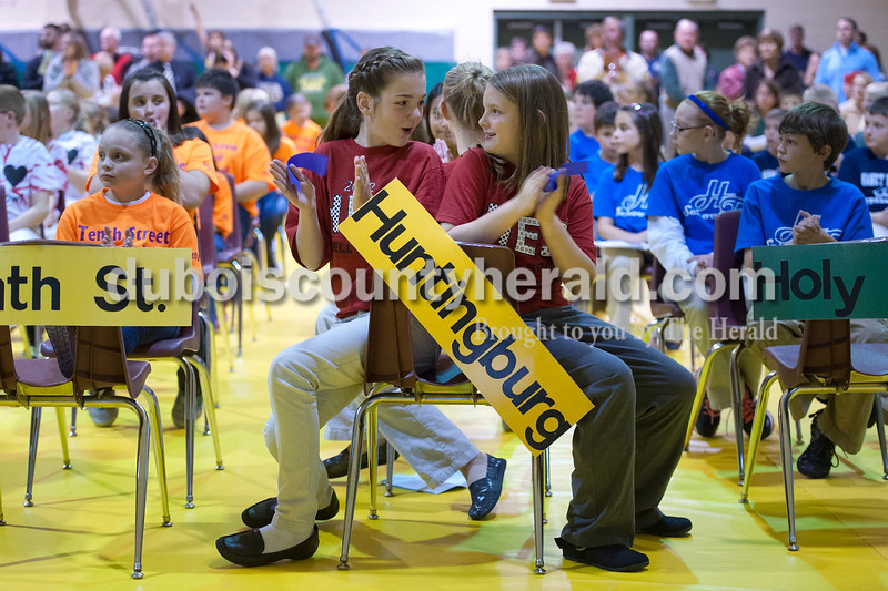 Olivia Corya/The Herald<br /> Huntingburg Elementary School fifth graders Evalyn Scherer, left, and Audra Hochgesang reacted as the final scores were announced after the Indiana Academic Spell Bowl Elementary Division at Ireland Elementary School on Thursday night. Their school placed first in Class 3.