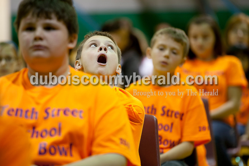 Olivia Corya/The Herald<br /> Tenth Street Elementary School fifth grader Huntter Fehribach yawned during the Indiana Academic Spell Bowl Elementary Division at Ireland Elementary School on Thursday night. His school placed second in Class 3.