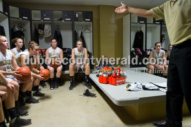Olivia Corya/The Herald<br /> Jasper's Lady Wildcats listened to their coach discuss strategy before Saturday night's game against Southridge at Cabby O'Neill Gymnasium. They defeated the Raiders 44-28.
