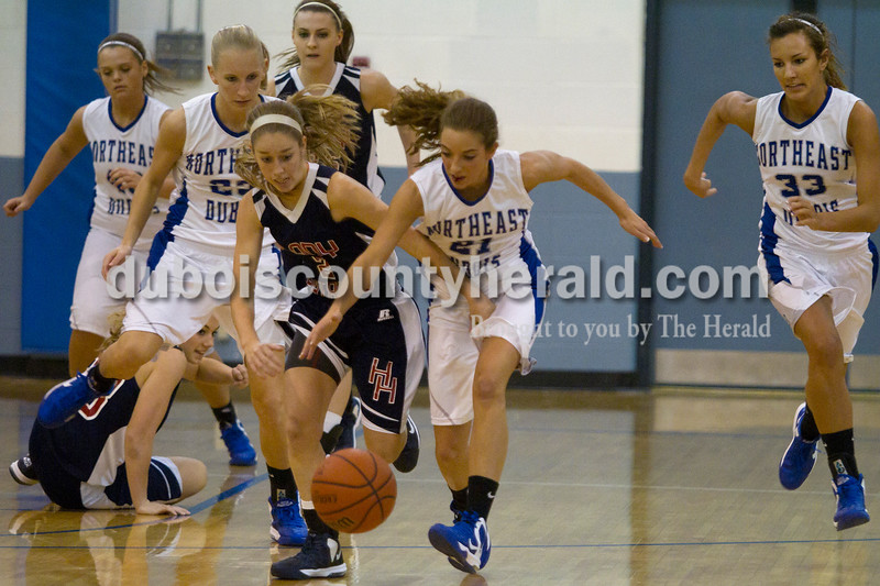 Olivia Corya/The Herald<br /> Heritage Hills' Greer Neff and Northeast Dubois' Emily Lueken battled for the ball during Saturday night's game in Dubois. The Jeeps defeated the Patriots 37-32.