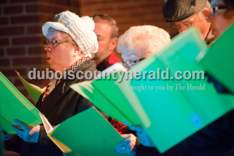Rachel Mummey/The Herald<br /> Soprano Clara Mae Vaal of Ferdinand sang with members of the St. Ferdinand Church Choir as part the opening ceremonies of the 15th annual Christkindlmarkt at the Monastery of Immaculate Conception in Ferdinand Friday.