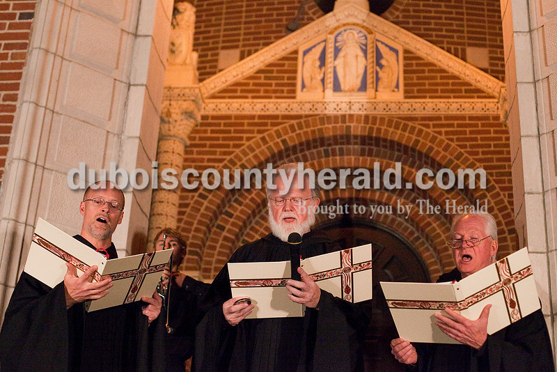 Rachel Mummey/The Herald<br /> Fathers Adrian Burke, Jeremy King and Sean Hoppe of St. Meinrad Archabbey chanted during the opening ceremonies of the 15th annual Christkindlmarkt at the Monastery of Immaculate Conception in Ferdinand Friday.