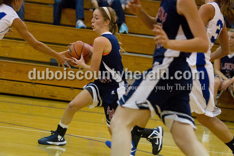Olivia Corya/The Herald<br /> Heritage Hill's Greer Neff pushed the ball up the court during Saturday night's game in Dubois. The Jeeps defeated the Patriots 37-32.