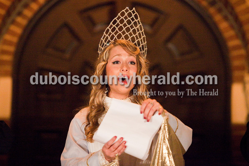 Rachel Mummey/The Herald<br /> The Christkindl Angel, portrayed by Hilary Cremeens of Ferdinand, sang during the opening ceremonies of the 15th annual Christkindlmarkt at the Monastery of Immaculate Conception in Ferdinand Friday. Cremeens, who played the role last year, attends Lipscomb University in Nashville and came home for the event.