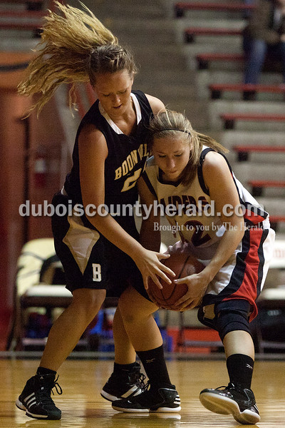 Southridge's Kayley Main, right, and Boonville's Sara Butts battled for the rebound during Monday night's game at Memorial Gym in Huntingburg. Dave Weatherwax/The Herald