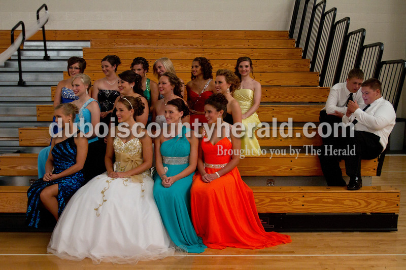 The fourteen women competing in the Dubois County 4-H Fair Queen Contest posed for a photo as they waited for the judges to deliberate at Jasper Middle School Saturday. Rhegann B. Fetter of Huntingburg, 18, in the far right of the front row, was crowned Queen, and she will reign over the fair from July 15 to 21.  Olivia Corya/The Herald