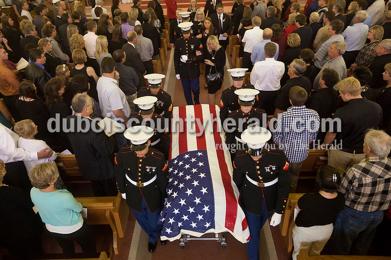 Marine pallbearers carried the body of Lance Cpl. Alec Terwiske out of St. Celestine Catholic Church following Friday morning's funeral for the Marine. Terwiske, 21, died while serving in Afghanistan on Sept. 3. Dave Weatherwax/The Herald
